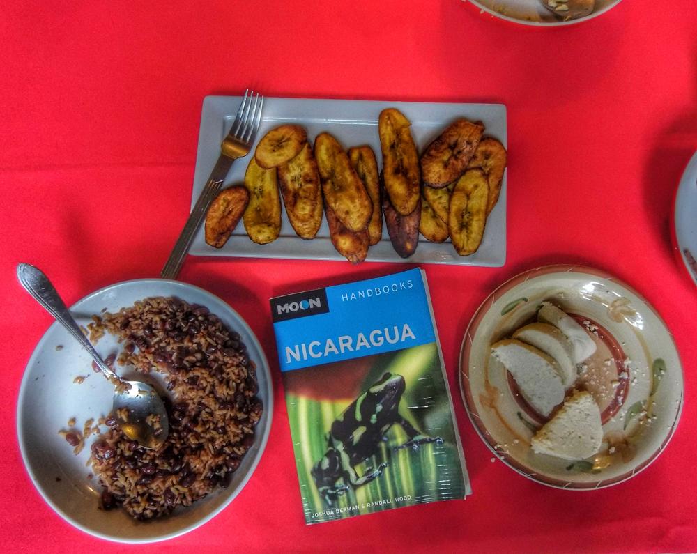 Desayuno típico! Moon Nicaragua travel guide with maduro, gallo pinto, y cuajada. In Matagalpa, Nicaragua.