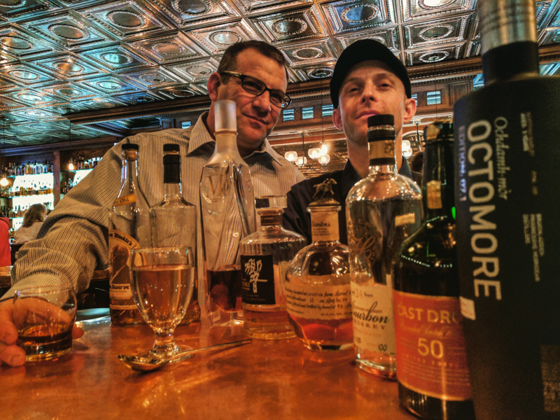 """""""I'm going to start you guys off with some Scotches,"""" says Logan Rushing, the Head Bartender and Whiskey Curator for the Stanley Hotel, as he lines up two perfect rows of glasses and between them, a bottle of 15-year Highland Park Scotch whiskey."""