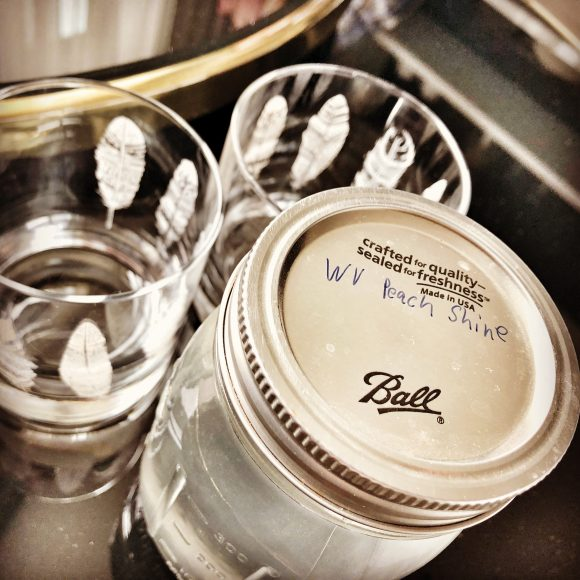 Then we went up to my room, where Jeff had left his fiddle and a Mason jar of peach-infused moonshine from — where else? — West Virginia.