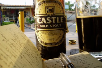 Moleskine and milk stout. Accra, Ghana.