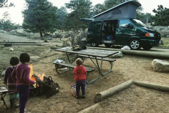 The Berman girls hanging out in Moraine Park Campground, in Rocky Mountain National Park, with our rented Eurovan from Rocky Mountain Campervans